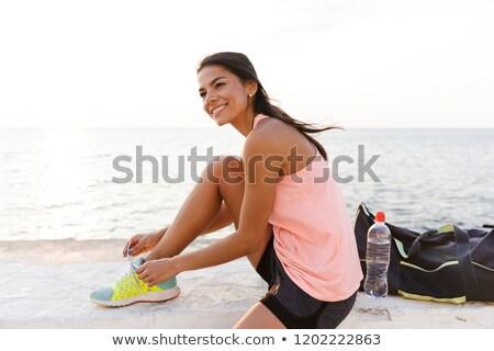 Photo séduisant femme 20s survêtement Photo stock © deandrobot