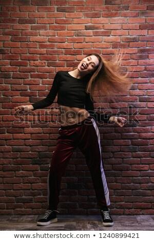 Full length photo of seductive hip hop dancer or sporty girl, da Stock photo © deandrobot