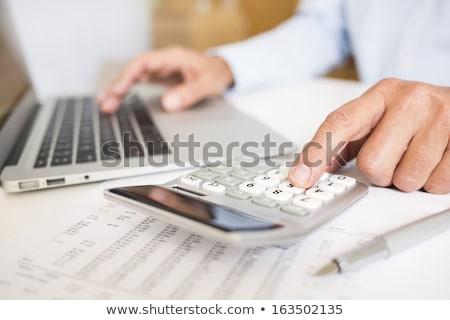 Człowiek pracy laptop numery rachunkowości wektora Zdjęcia stock © robuart