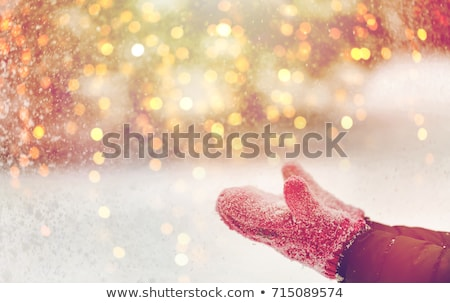 close up of woman throwing snow outdoors Stock photo © dolgachov
