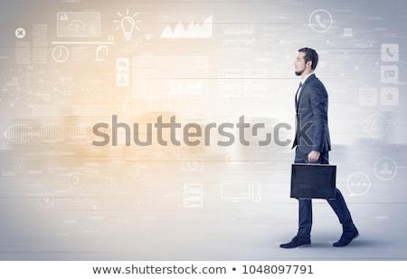 Stok fotoğraf: Businessman walking with database concept around