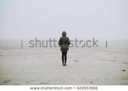 Mulher costa oceano ondas mão sol Foto stock © Genestro
