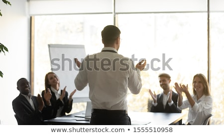 Enthusiastic group of businessman applauding Stock photo © Giulio_Fornasar
