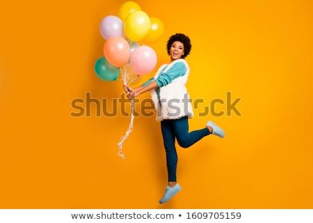 Glimlachende vrouw Geel trui Blauw broek zak Stockfoto © robuart