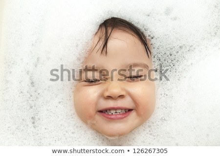 Toddler showing face just above water surface. Stock photo © Lopolo