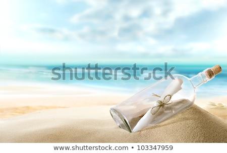 üveg víz tengerparti homok nyár homok műanyag Stock fotó © dolgachov