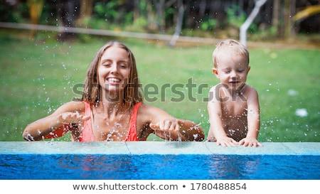 Mother and son in a tropical garden Stock photo © galitskaya