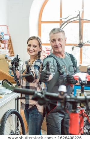 vrouw · man · fiets · mechanica · workshop · meisje - stockfoto © kzenon