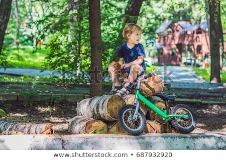 little boy and his bicycle preschool childs first day on the bike the joy of movement stock photo © galitskaya