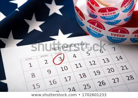 Elezioni giorno USA emblema calendario pulsante Foto d'archivio © Oakozhan