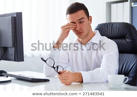 tired businessman rubbing eyes at office Stock photo © dolgachov