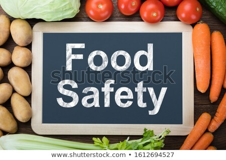 Fresh Vegetables Around Food Safety Text On Slate Board Stock photo © AndreyPopov