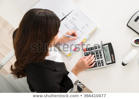 Accountant Woman Calculating Corporate Tax Stock photo © AndreyPopov