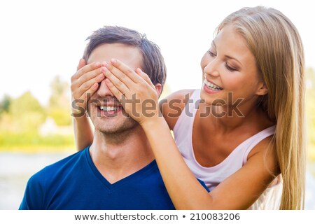 Guess who. young woman covering eyes of her boyfriend Stock photo © GVS