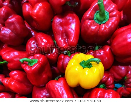 Single red Bell pepper among green peppers Stock photo © Balefire9
