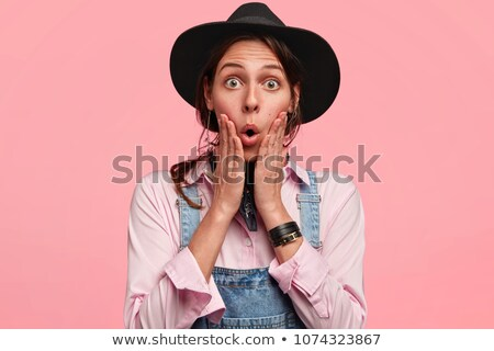 Shocked woman wearing a hard hat Stock photo © photography33