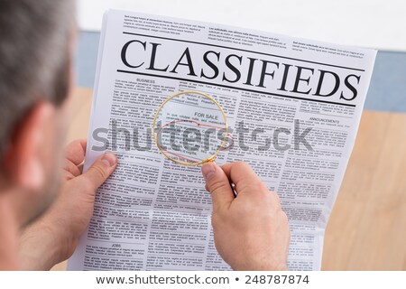 man reading classified ads stock photo © photography33
