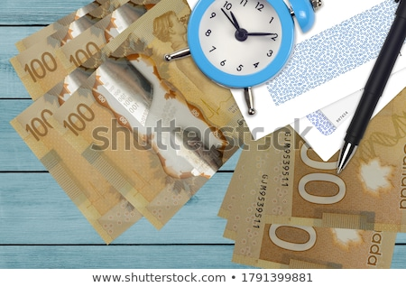 clock and canadian dollars Stock photo © devon