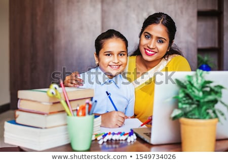 mother and young daughter doing her homework Stock photo © photography33