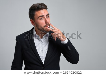 moço · cigarro · cara · feliz · fumar - foto stock © stockyimages