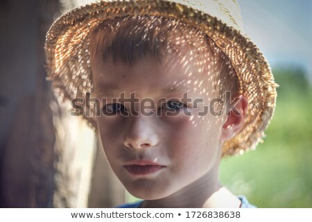 Closeup of a young boy in a straw hat Stock photo © photography33