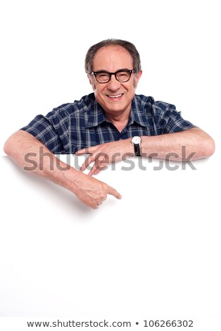 Smiling aged man posing with blank billboard stock photo © stockyimages