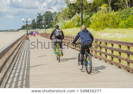 Couple walking along a pontoon Stock photo © photography33
