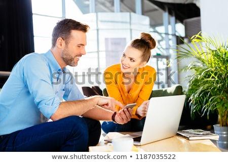 Mosolyog üzletember okostelefon férfi okostelefon kéz Stock fotó © adamr