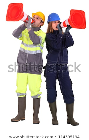 A team of tradespeople yelling into pylons Stock photo © photography33