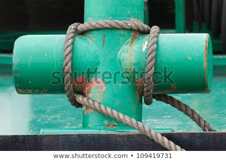 Stock photo: Rope tied on a post at harbor