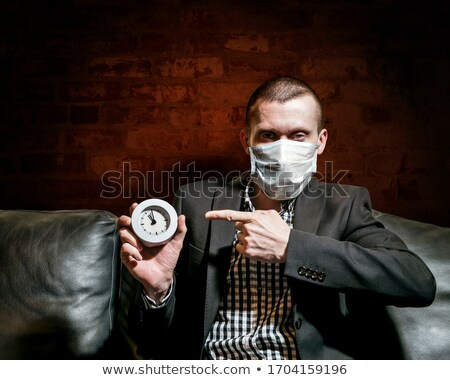 Stern businessman with a clock Stock photo © photography33