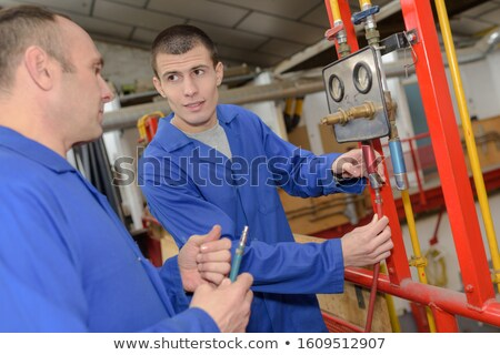 Plumber instructing his apprentice Stock photo © photography33
