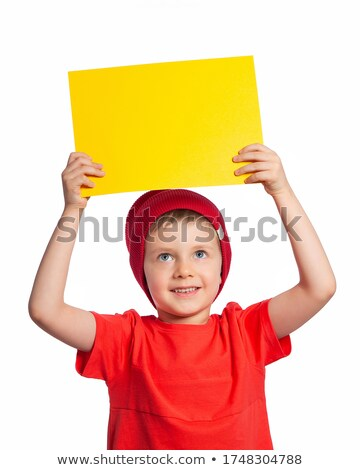 Boy holding banner ad above his head Stock photo © stockyimages