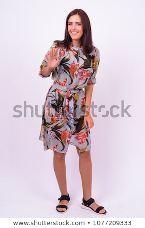 Smiling businesswoman in thoughts against a white background Stock photo © wavebreak_media