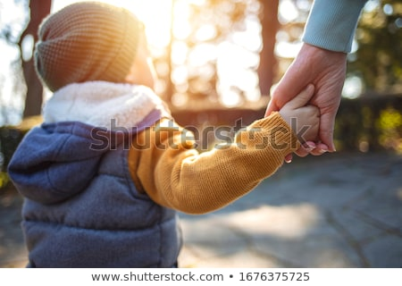 close up of a hand holding the little hand of a baby stock photo © wavebreak_media