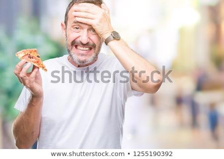 Mature delivery man holding pizza  Stock photo © wavebreak_media