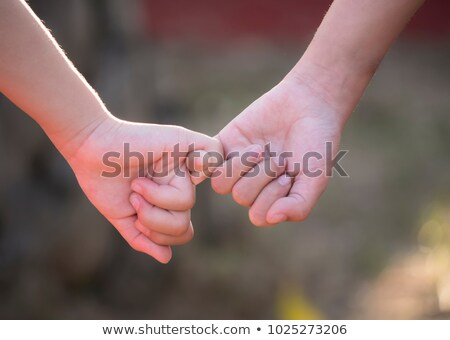 Happy young girl with clasped hands Stock photo © stockyimages
