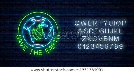 Eco sign on the brick wall . Concept Stock photo © dashapetrenko