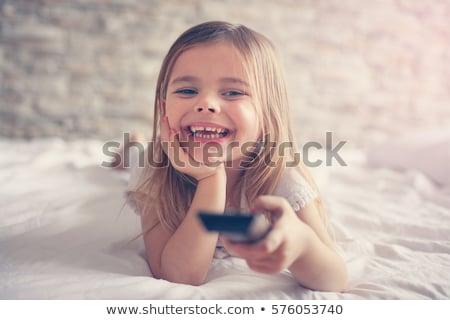 Menina controle remoto assistindo controlar Foto stock © Spectral