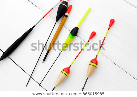 Stock photo: Fishing tackle on wooden surface.