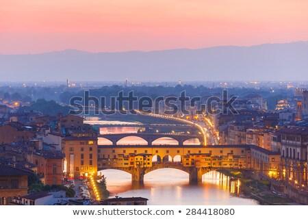 ponte vecchio bridge in florence at night stock photo © elnur