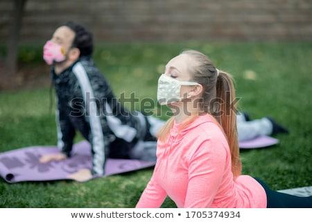 nina · yoga · nino · parque · puesta · de · sol - foto stock © hasloo