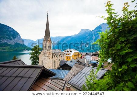 View of Hallstatt village with Christuskirche church bell tower Stock photo © pixachi