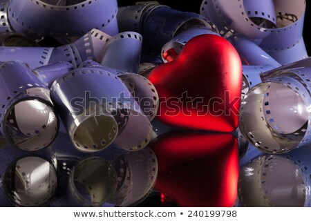 Close-up of a roll 35 mm photographic films and love symbol Stock photo © CaptureLight