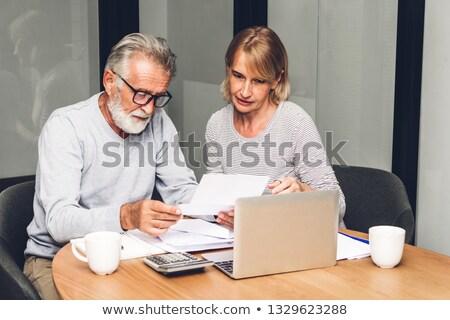 Seniors Reading Document Stock photo © cteconsulting