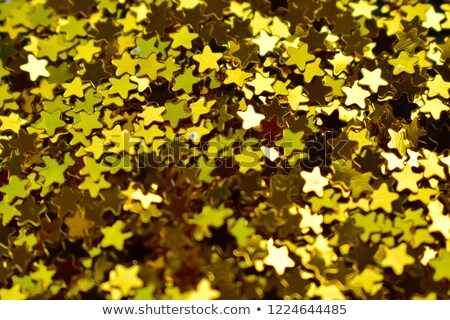 colorful sweet background with gold star sprinkles stock photo © dariazu