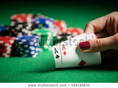 nő · játszik · póker · fiatal · kétségbeesett · hazárdjáték - stock fotó © hsfelix