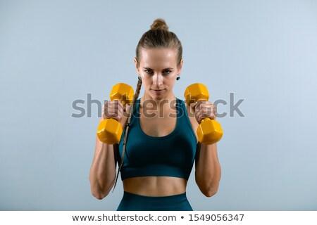 фитнес · девушки · зеленый · гантели · розовый · брюки - Сток-фото © photoline