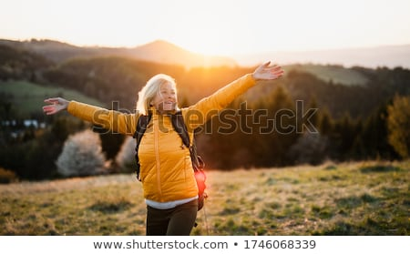 Senior mulher andar ao ar livre eighties assistindo Foto stock © PixelsAway