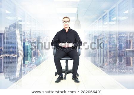 Stern businessman sitting on an office chair Stock photo © wavebreak_media